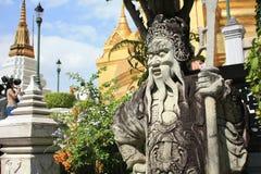 Estátua de pedra no templo Wat Phra Kaew Fotografia de Stock Royalty Free