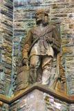 Estátua de pedra velha de um Frontiersman Fotografia de Stock