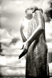 Estátua de uma menina com sol beijada Foto de Stock