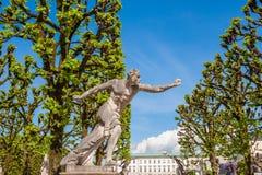 Estátua do atleta na entrada do jardim de Mirabell em Salzburg, Áustria Foto de Stock Royalty Free
