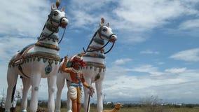 Estátua do deus e do cavalo em exterior fotografia de stock