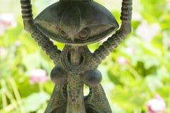 Estátua do ferro no jardim Imagens de Stock