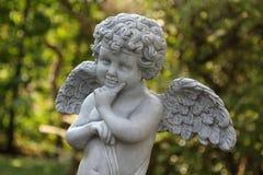 Estátua do jardim decorada no jardim fotografia de stock