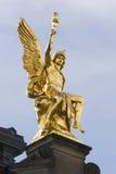 Estátua dourada de assento Fotos de Stock