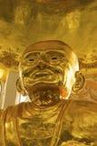 A estátua dourada a mais grande da monge fotografia de stock royalty free