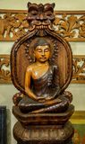 Estátua feita de madeira de Lord Buddha Imagens de Stock