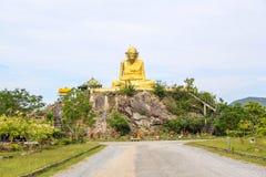 A estátua a mais grande de plutônio Thuat de Luang em Phatthalung, Tailândia Fotografia de Stock Royalty Free