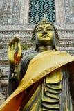 Estátua preta da Buda do ouro Fotos de Stock Royalty Free