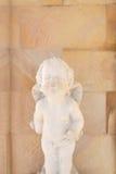 Estátua velha do cupido Fotos de Stock