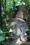 Estátua velha do deva foto de stock