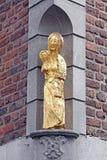 Estátua velha na construção - Aix-la-Chapelle, Alemanha Imagem de Stock Royalty Free