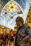 Estátua viva em luzes de Natal de Malaga Imagem de Stock