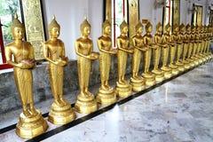 Estátuas da doação da Buda Fotos de Stock Royalty Free