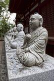 Estátuas de assento de Buddha Imagem de Stock Royalty Free