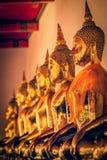 Estátuas de assento de Buddha, Tailândia Foto de Stock