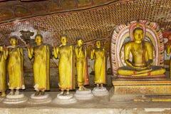 Estátuas de Buddha no templo da rocha de Dambulla, Sri Lanka imagens de stock royalty free