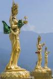 Estátuas de deusas budistas no monte superior no parque natural de Kuenselphodrang, Thimphu, Butão Foto de Stock Royalty Free
