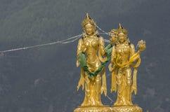 Estátuas de deusas budistas no monte superior no parque natural de Kuenselphodrang, Thimphu, Butão Fotografia de Stock Royalty Free