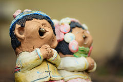 Estátuas do menino e da menina Fotografia de Stock