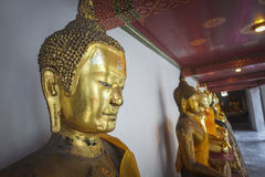Estátuas douradas de buddha Imagens de Stock