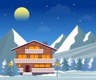Estância de esqui, hotel ou casa da família do inverno na noite Foto de Stock