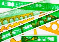 Estêncis verdes e alaranjados imagem de stock