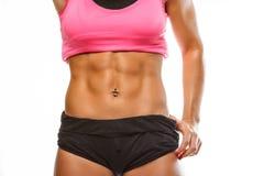 Estómago muscular del ` s de la mujer Imagen de archivo libre de regalías