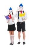 Estúdio disparado de mimes engraçados com livros Fotos de Stock
