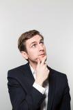 Estúdio disparado do homem de negócios pensativo Fotografia de Stock