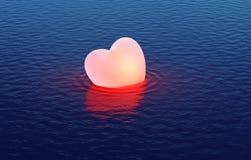 Est tombé le coeur flottant au-dessus de l'eau Images stock