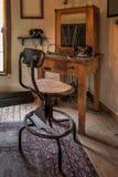 Estação do ` s do operador de telefone com cadeira Imagens de Stock Royalty Free