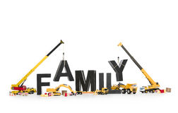 Establish a family: Machines building family-word. Royalty Free Stock Photography