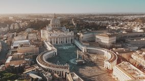 Establishing aerial shot of Vatican City. Crowded St. Peter`s Square