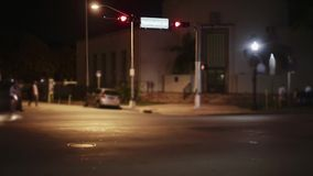Establishing evening shot of street in Miami with cars and people passing by. Establishing shot of street in Miami. You can see cars, bus, taxi and stock video footage