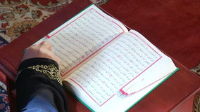 Establishing Islamic holy book Quran pages change stock video