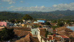 Establishing a panning shoot in the town of Trinidad on Cuba. Recorded on a mountain. In sunny weather condition mountains are in the background. The clip ends stock video