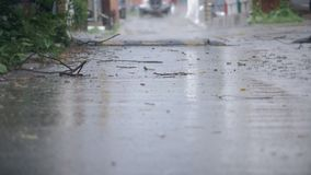 Establishing shot of an alleyway during a hard rain. 4K stock video