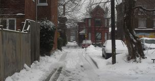 Establishing shot of an alleyway after winter storm. Cinematic 4K footage stock footage