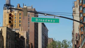 Establishing Shot of Broadway Streetsign. A daytime establishing shot of a Broadway street sign stock video footage