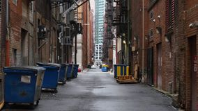 Establishing Shot of Empty Alleyway in a Large City. A daytime overcast establishing shot of an empty alley in a big city stock video