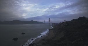 Establishing shot of the Golden Gate Bridge. Beautiful aerial establishing shot of the Golden Gate Bridge in San Francisco, California at sunset stock video footage