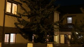 Establishing shot of house automation turning lights on and off on night time - stock footage