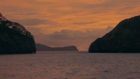 Establishing shot of an island studded ocean at sunset. Beautiful sunset on an island studded ocean.  4K UHD footage stock video