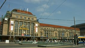 Leipzig, Germany, main station. Establishing shot of the main station in Leipzig, Germany, including the very busy four lane tram station in front of the main stock video footage