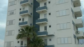 Establishing shot of multi-storey apartment building in exotic country. Realty. Stock footage stock video footage