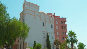 Establishing shot of typical spanish apartment building and palm tree, Tarragona city, Costa Daurada, Spain. Tarragona City in Catalonia, Costa Daurada, Spain stock footage