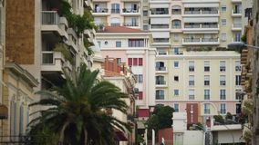 Establishing shot of window in modern European apartment building, cityscape stock video footage