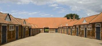 Establos y yarda en Norfolk Imagenes de archivo