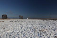 Estación de bombeo en paisaje del invierno Fotos de archivo