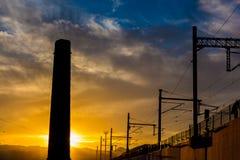 Estación de tren en puesta del sol Foto de archivo libre de regalías